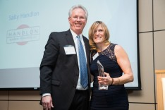 Outgoing LVEDC Board of Directors Chairman Tom Garrity (left) presented the MVP of the Year Award to Sally Handlon (right).
