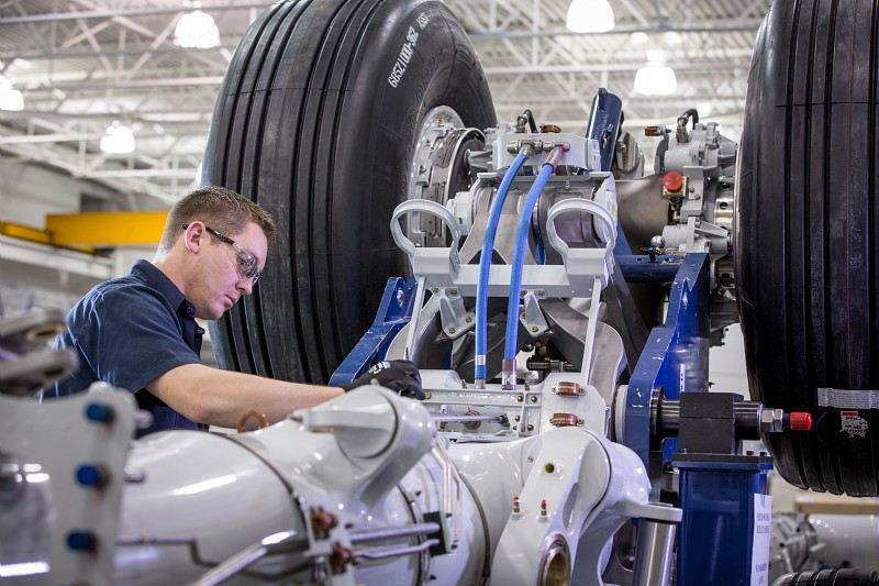 A Safran employee repairing the landing gear of a Boeing 787 at the company's Toronto facility. (Photo courtesy Christian Fleury / CAPA Pictures / Safran)