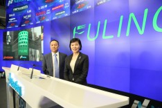 Fuling Plastics CEO Xin Fu Hu and President Guilan Jiang at the NASDAQ Opening Bell Ceremony.