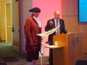 Ben Franklin (portrayed by Touchstone Theater founder Bill George) handing R. Chadwick Paul, Jr., the keys to the new Ben Franklin TechVentures West Wing addition.