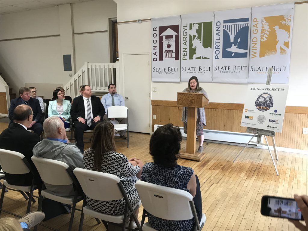 Pen Argyl Councilwoman Janell Connolly unveiling the banners behind her, which are part of the rebranding campaign organized by Slate Belt Rising.