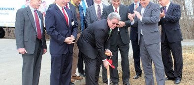 Dan Marcante, HCSC vice president and COO, scoops the first shovelful of dirt at the groundbreaking ceremony.