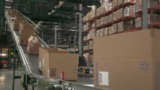 The new e-commerce center will have the capacity to process hundreds of thousands of packages each day.