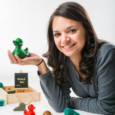 Lauren Villaverde holding one of the puzzles from her company, Stackablz.