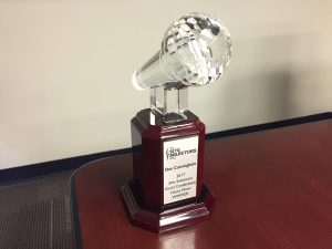 The trophy Don Cunningham received from the 2017 Site Selectors Guild Conference Talent Show.