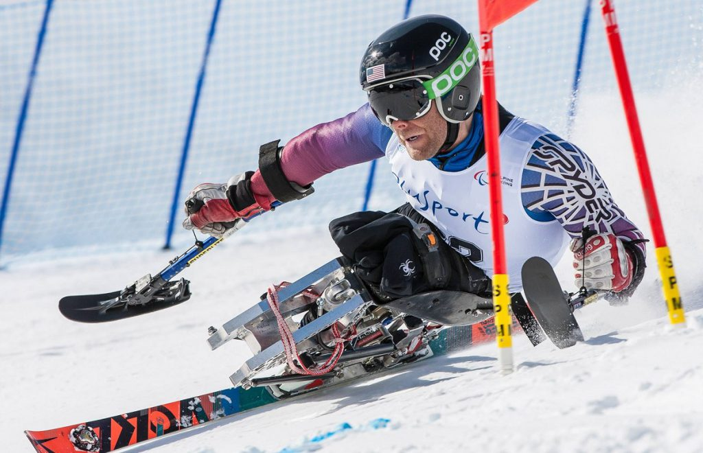 Tyler Walker, a member of the U.S. alpine ski team in the upcoming 2018 Paralympics, using a monoski made by Bethlehem-based DynAccess. (photo by Marcus Hartman)