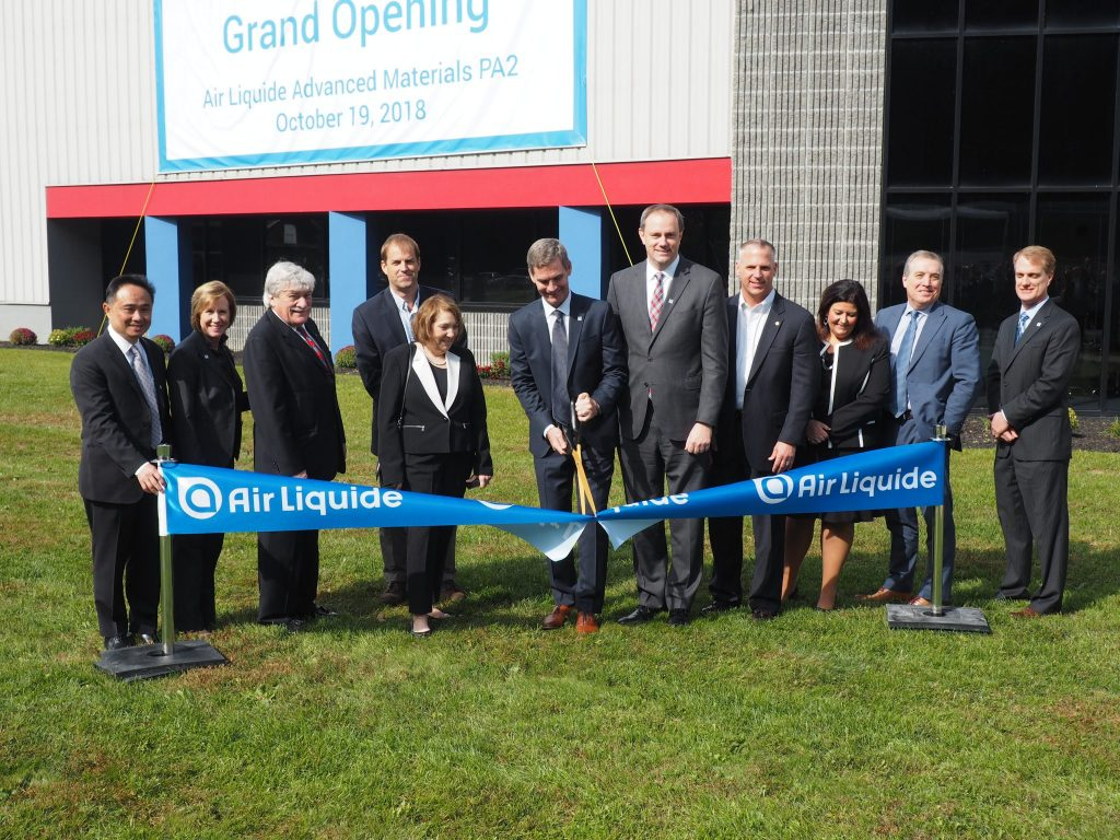 Paul Burlingame, President and CEO of Air Liquide Advanced Materials, cuts the ribbon at the newly-expanded Air Liquide facility in Upper Mount Bethel Township.