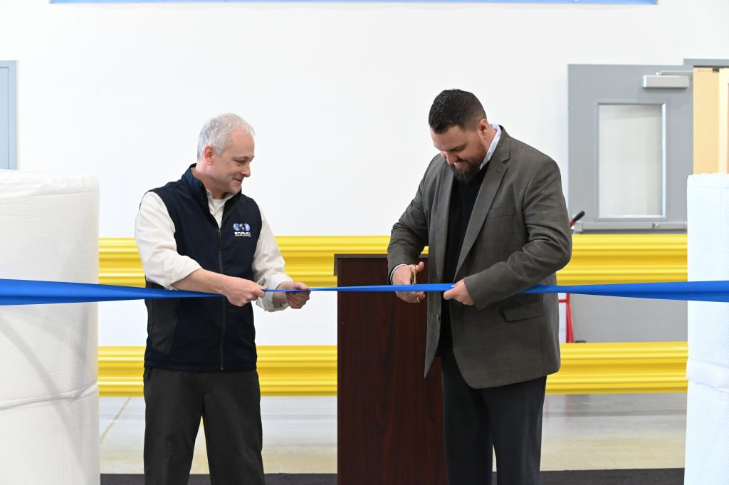 Plant Manager Joseph Schott and Kevin Johnson, Director of Global Operations at PAC Worldwide (respectively), at the ribbon-cutting event in Lower Nazareth Township.