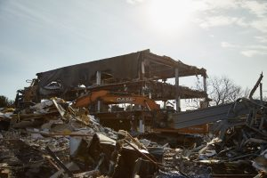 Demolition has begun on the former Guardian building at 3900 Burgess Place. (photo by J Taylor Design)