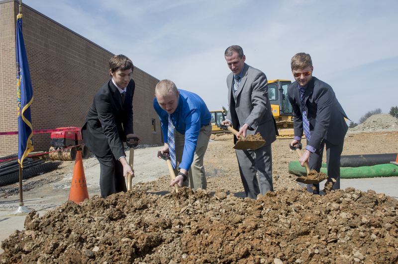 Welding Technology students Jordan Everett (left) and Bradley Gardner (second from left) participate in the ceremonial groundbreaking for LCTI's new Welding Technology Center with their teachers Brad Brandmeir (second from right) and Thomas Uff. (photo courtesy LCTI)
